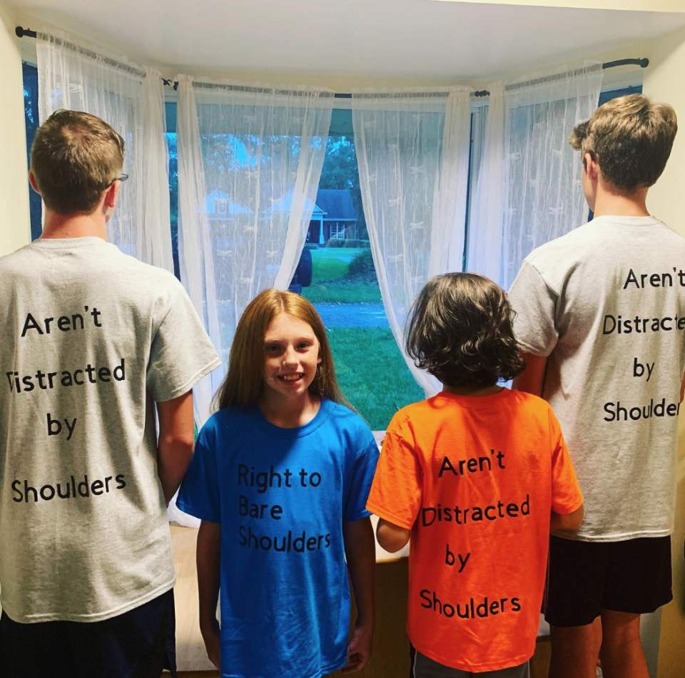 "In response to a dress code violation, students wore t-shirts that read ""right to bare shoulders"" and ""Real men aren't distracted by shoulders"" to school. (Photo: Kate Darrow)"