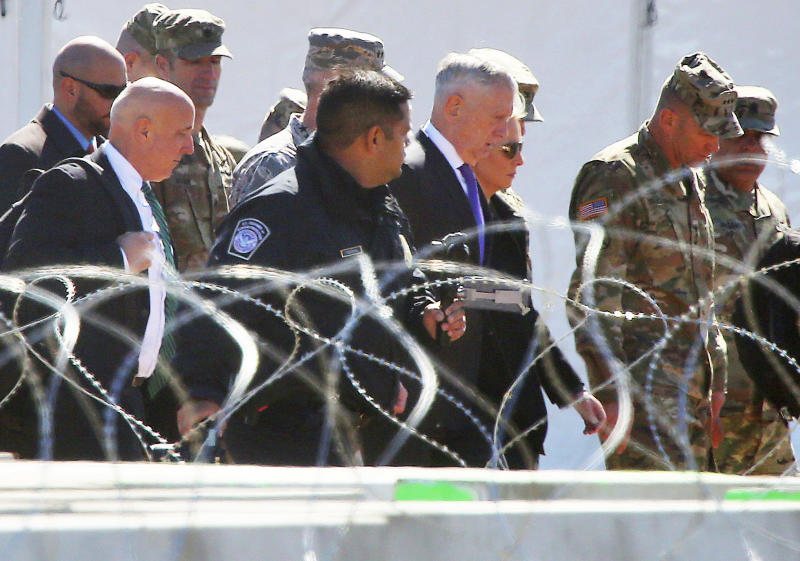 U.S. Secretary of Defense James Mattis and Homeland Security Secretary Kirsten Nielsen, third from the right, visit Base Camp Donna on Wednesday, Nov.14, 2018, in Donna, Texas. (Joel Martinez/The Monitor via AP)