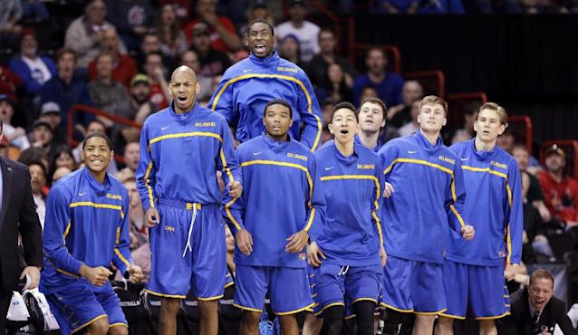 Players on Delaware's bench react as their team make a run against Michigan State in the first half during the second round of the NCAA college basketball tournament in Spokane, Wash., Thursday, March 20, 2014. (AP Photo/Elaine Thompson)