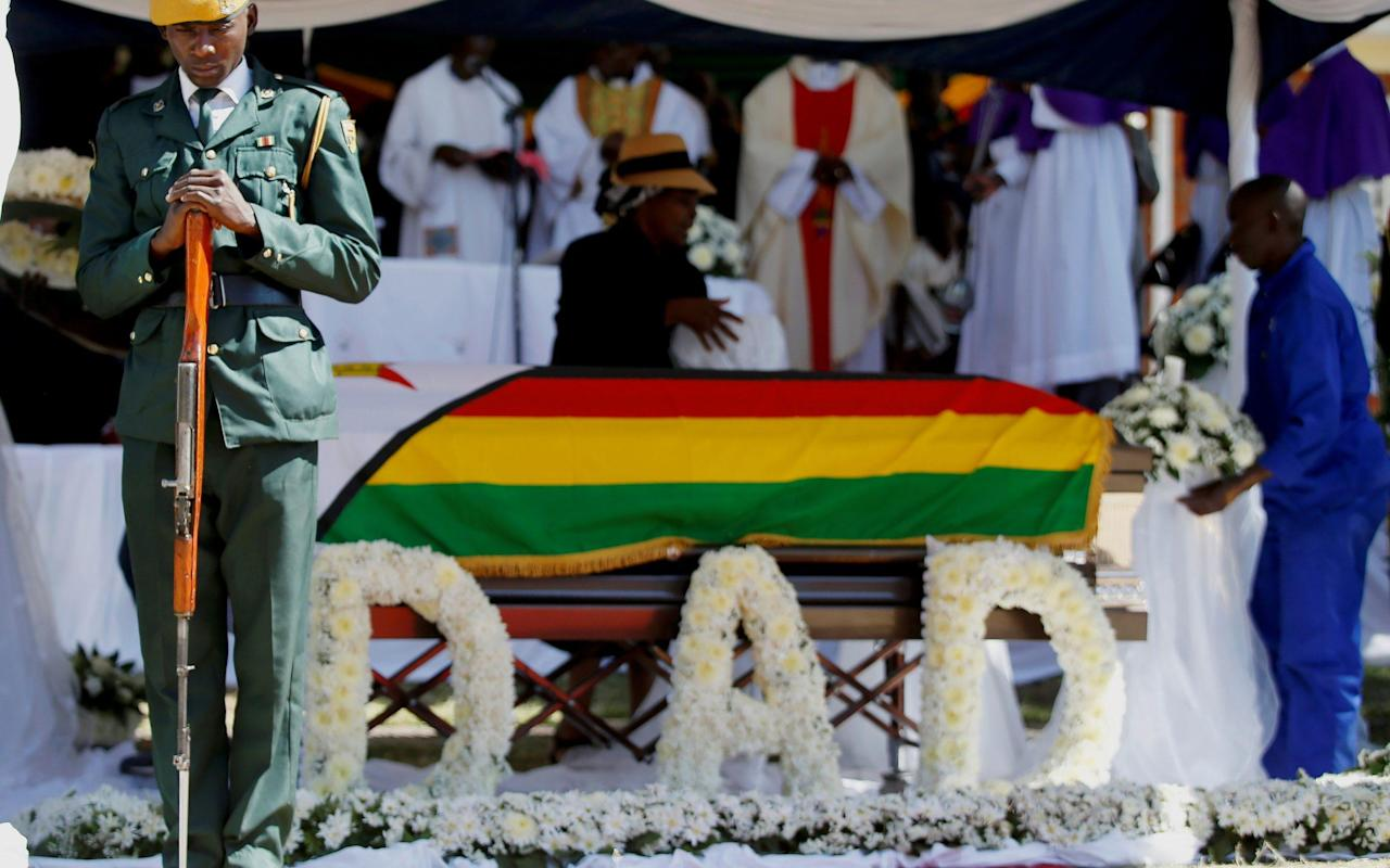 Robert Mugabe buried in private ceremony after weeks of drama over former Zimbabwean leader's resting place