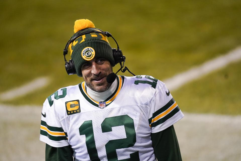 Green Bay Packers' Aaron Rodgers smiles as he is interviewed after an NFL football game against the Chicago Bears Sunday, Jan. 3, 2021, in Chicago. The Packers won 35-16. (AP Photo/Charles Rex Arbogast)