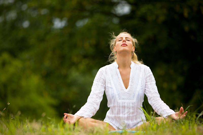 "This cooling breath is the perfect antidote to a long, stressful day. ""It releases tension in body and mind, and helps us relieve stress and anger and brings us to a more balanced and clear state,"" says Bielkus. To perform this refreshing pranayama exercise, sit in a chair or on the floor in an easy crossed-legged position with your eyes closed. Stick your tongue out and curl up its outer edges. (If you're having trouble tongue curling, try your best and form a slight ""O"" with the mouth). Inhale through the mouth, letting the air pass over the tongue, feeling a cool breath, and then exhale through your nose. ""Continue long rhythmic breathing for three minutes,"" she says. ""You'll feel totally refreshed!"""