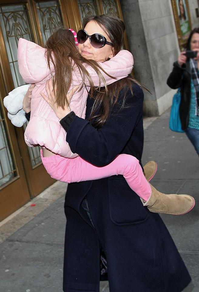 No matter how big Katie Holmes and Tom Cruise's daughter gets, she never seems to be too big to be carried. While no one paid much attention the first few years, now that little Suri has reached age 7, getting constantly carted around by mom seems a little odd (not to mention bad for Katie's back). Though some have said she carries her daughter to shield her from the paparazzi, we can point to tons of very famous celeb parents (Angelina Jolie and Brad Pitt; Jennifer Garner and Ben Affleck; and Gwen Stefani and Gavin Rossdale, for example) who are often swarmed by paps, but still seem to encourage their kids to stand on their own two feet.
