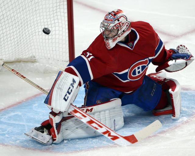 Montreal Canadiens goalie Carey Price (31) lets in the second goal of the game against the New Jersey Devils during second period National Hockey League action, Tuesday, Jan. 14, 2014, in Montreal. (AP Photo/The Canadian Press, Ryan Remiorz)