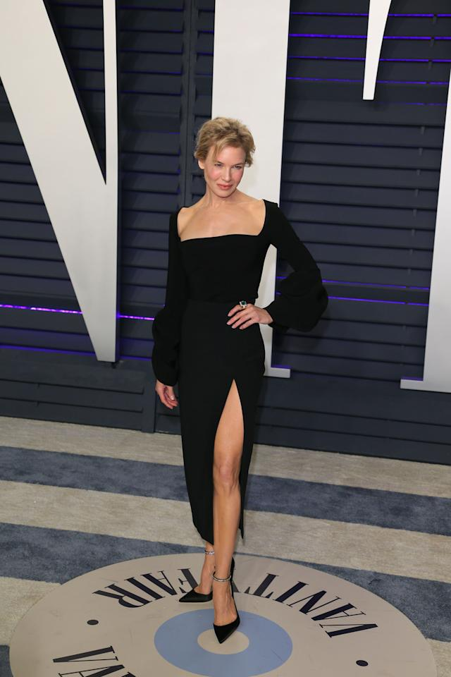 <p>Wearing a thigh-high split black dress. <em>[Photo: Getty]</em> </p>