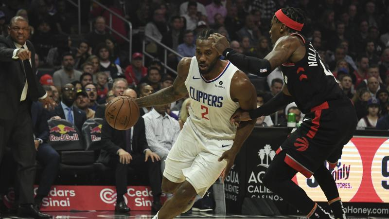 Nov 11, 2019; Los Angeles, CA, USA; LA Clippers forward Kawhi Leonard (2) drives to the basket against Toronto Raptors forward Rondae Hollis-Jefferson (4) during the first half at Staples Center. Mandatory Credit: Richard Mackson-USA TODAY Sports