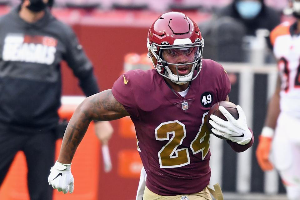 LANDOVER, MARYLAND - NOVEMBER 22: Antonio Gibson #24 of the Washington Football Team carries the ball against the Cincinnati Bengals during the second half at FedExField on November 22, 2020 in Landover, Maryland. The Washington Football Team defeated the Bengals 20-9. (Photo by Mitchell Layton/Getty Images)