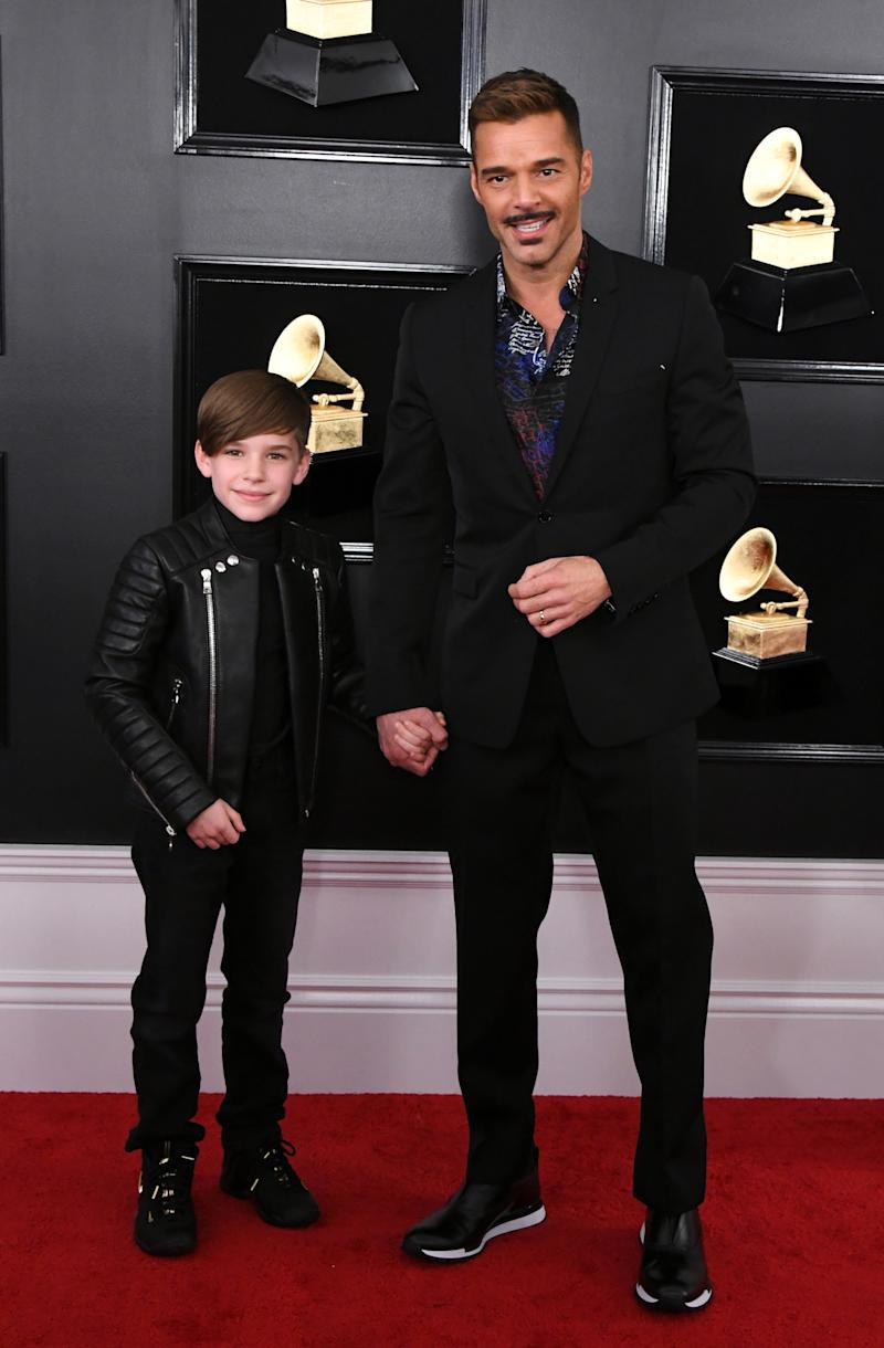 Under other circumstances, we'd likely have something to say about Ricky Martin's mustache, but we're too distracted by how cute his 10-year-old son is!!!