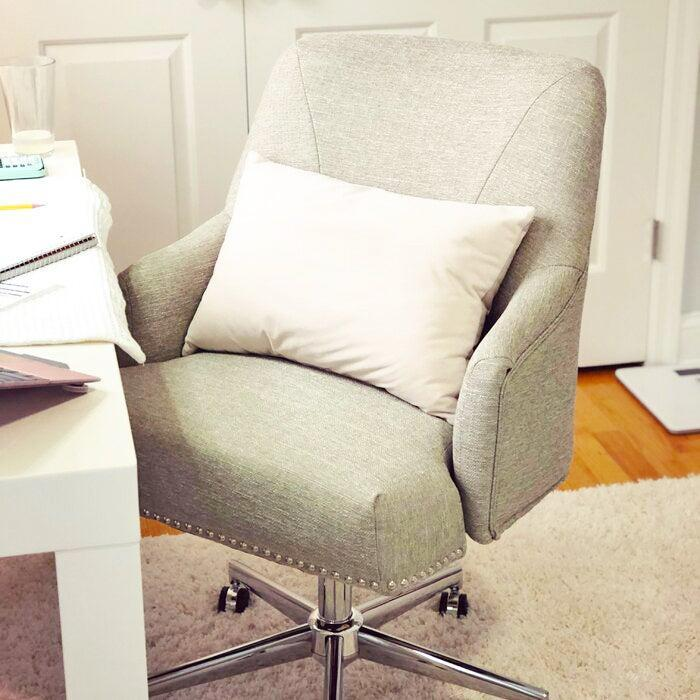 """<h2>Serta Leighton Task Chair</h2><br>As a proud owner of this particular bestselling office chair, I can speak first-hand to its excellent quality (both body-support-wise and aesthetically speaking). Reviewers share my sentiments by describing this seat as comfortable enough to sit in four hours, beautiful, and very easy to put together.<br><br><strong>4.7 out of 5 stars and 1,667 reviews</strong><br>""""Ordered this chair in blue in March when I started working from home. It is durable, stable, stylish, comfortable and I have not had a single backache since I starting using it. I do use a small lumbar pillow with it, but it's super comfy either way. Amazing chair at any price!"""" <em>– Wayfair Reviewer</em><br><br><em>Shop <strong><a href=""""https://www.wayfair.com/furniture/pdp/serta-at-home-serta-leighton-task-chair-w001282418.html"""" rel=""""nofollow noopener"""" target=""""_blank"""" data-ylk=""""slk:Wayfair"""" class=""""link rapid-noclick-resp"""">Wayfair</a></strong></em><br><br><strong>Serta at Home</strong> Leighton Task Chair, $, available at <a href=""""https://go.skimresources.com/?id=30283X879131&url=https%3A%2F%2Fwww.wayfair.com%2Ffurniture%2Fpdp%2Fserta-at-home-serta-leighton-task-chair-w001282418.html"""" rel=""""nofollow noopener"""" target=""""_blank"""" data-ylk=""""slk:Wayfair"""" class=""""link rapid-noclick-resp"""">Wayfair</a>"""