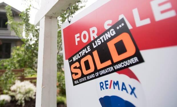 Some investors are pooling their money to buy a share of properties through crowdfunding. (Jonathan Hayward/The Canadian Press - image credit)