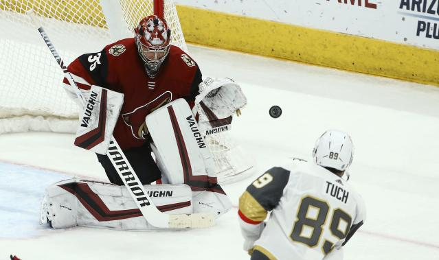 Arizona Coyotes goaltender Darcy Kuemper (35) makes a save on a shot by Vegas Golden Knights right wing Alex Tuch (89) during the second period of an NHL hockey game Sunday, Dec. 30, 2018, in Glendale, Ariz. (AP Photo/Ross D. Franklin)
