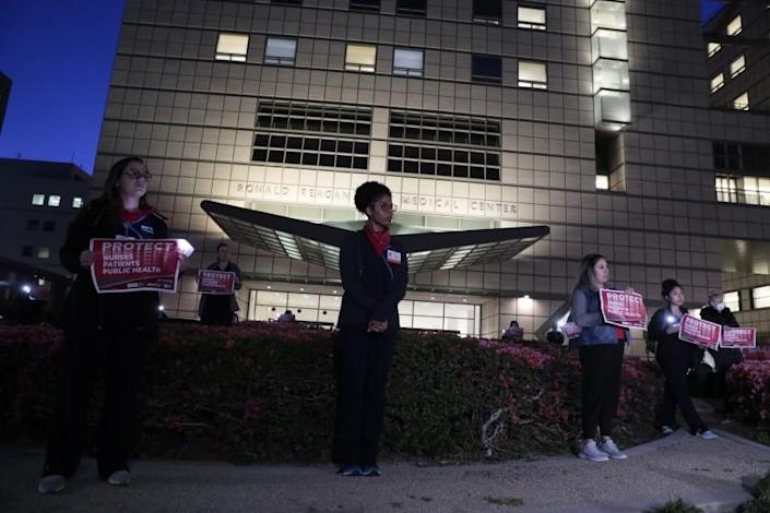 """WESTWOOD, CA, MONDAY, MARCH 30, 2020 - Healthcare workers gather outside UCLA Ronald Reagan Medical Center to call for further action from the federal government's in reaction to the Covid 19 outbreak. (Robert Gauthier/Los Angeles Times) <span class=""""copyright"""">(Robert Gauthier/Robert Gauthier/Los Angeles Times)</span>"""