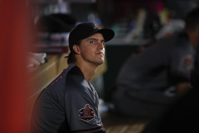Arizona Diamondbacks starting pitcher Zack Greinke sits in the dugout during the sixth inning of a baseball game against the Los Angeles Angels, Monday, June 18, 2018, in Anaheim, Calif. (AP Photo/Jae C. Hong)