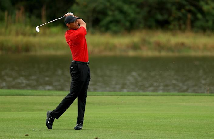 Tiger Woods sighting? Photo indicates Tiger is back on the golf course watching over son Charlie, club in hand
