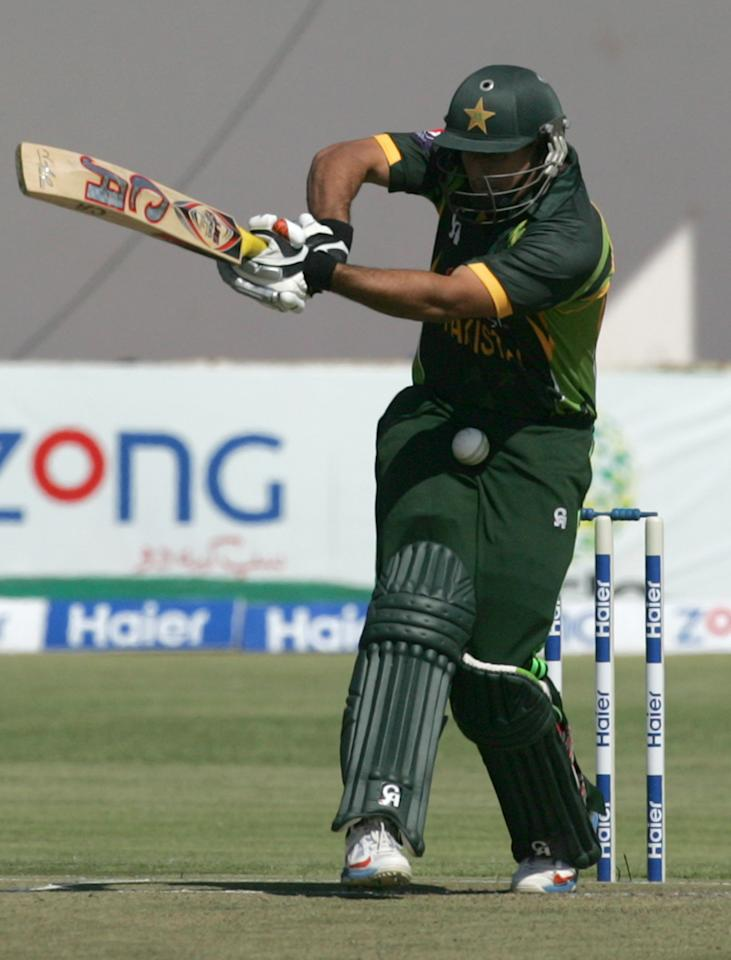 Pakistan's batsman Nasir Jamshed is hit by a ball during the second and final Twenty20 international between Zimbabwe and Pakistan at the Harare Sports Club on August 24, 2013.   AFP PHOTO / JEKESAI NJIKIZANA        (Photo credit should read JEKESAI NJIKIZANA/AFP/Getty Images)