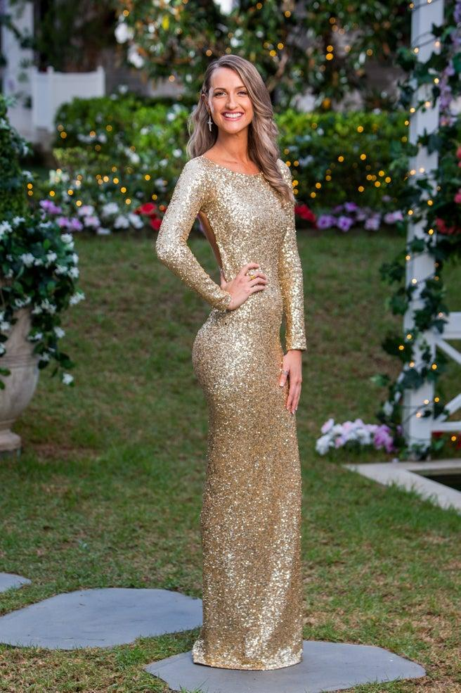 Isabelle Davies in a gold long-sleeved dress
