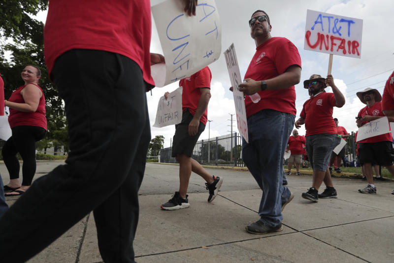 Members of the Communications Workers of America walk a picket line outside of an AT&T office, Monday, Aug. 26, 2019, in Miami. CWA union members in the southeast went on strike Friday over unfair labor practices by management during negotiations for a new contract. (AP Photo/Lynne Sladky)