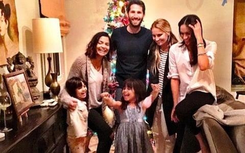 Meghan Markle Meghan is godmother to her friend Benita Litt's two daughters Remi, six and Rylan, seven, and she is thought to have spent Christmas with the family in 2016 (pictured)