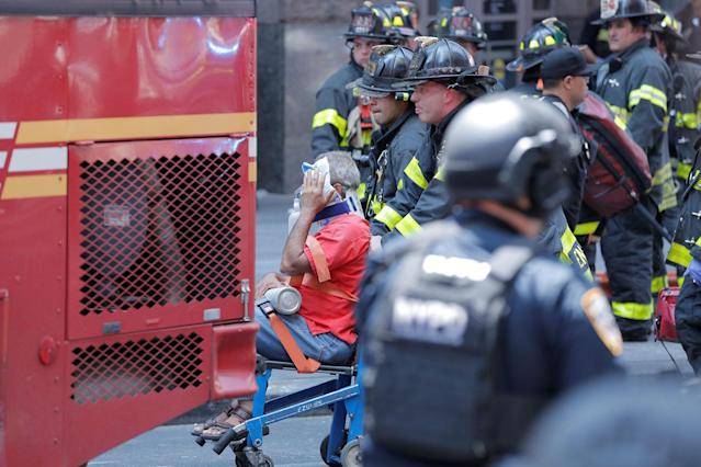 <p>First responders tend to an injured pedestrian after a vehicle struck pedestrians on a sidewalk in Times Square in New York on May 18, 2017. (Lucas Jackson/Reuters) </p>