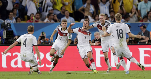 Germany's Mario Goetze (19) celebrates after scoring the opening goal during the World Cup final soccer match between Germany and Argentina at the Maracana Stadium in Rio de Janeiro, Brazil, Sunday, July 13, 2014. (AP Photo/Matthias Schrader)