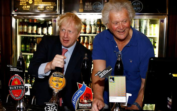 Tim Martin, pictured on the campaign trail with Boris Johnson last year - WPA Pool/Getty Images