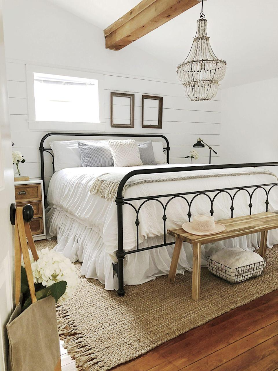 """<p>Shabby chic reigns in Kay Volmar's master bedroom, where <a href=""""https://www.behr.com/consumer/ColorDetailView/1850"""" rel=""""nofollow noopener"""" target=""""_blank"""" data-ylk=""""slk:Behr's Ultra Pure White"""" class=""""link rapid-noclick-resp"""">Behr's Ultra Pure White</a> creates a clean backdrop for perfectly patinaed decor. See the whole home <a href=""""https://www.southernliving.com/home/decor/kay-volmar-florida-cottage?slide=b7f74ec7-41e1-4dd2-a2b9-8c622cc83336#b7f74ec7-41e1-4dd2-a2b9-8c622cc83336"""" rel=""""nofollow noopener"""" target=""""_blank"""" data-ylk=""""slk:here"""" class=""""link rapid-noclick-resp"""">here</a>.</p>"""