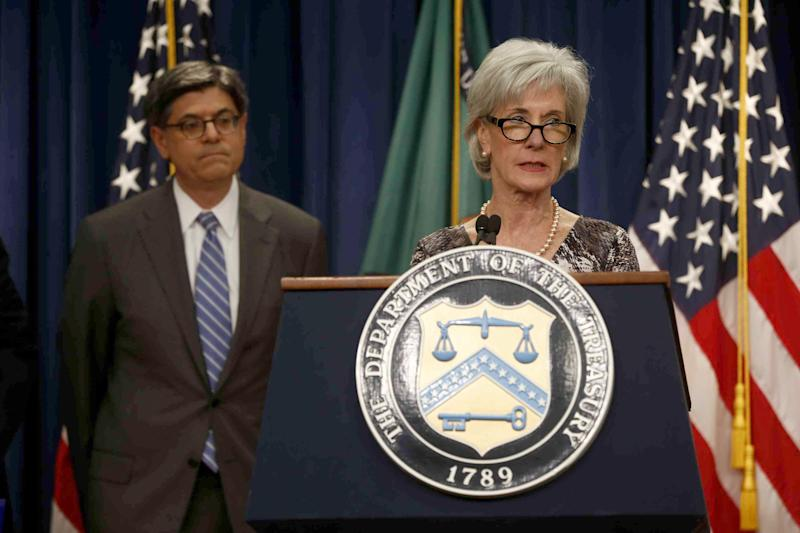 Treasury Secretary Jacob Lew listens at left as Health and Human Services Secretary Kathleen Sebelius speaks about Social Security and Medicare, Friday, May 31, 2013, at the Treasury Department in Washington. The government says Medicare's giant hospital trust will not be exhausted until 2026, while the date that Social Security will exhaust its trust fund is unchanged at 2033. The date for Medicare is two years later than was projected last year. (AP Photo/Charles Dharapak)