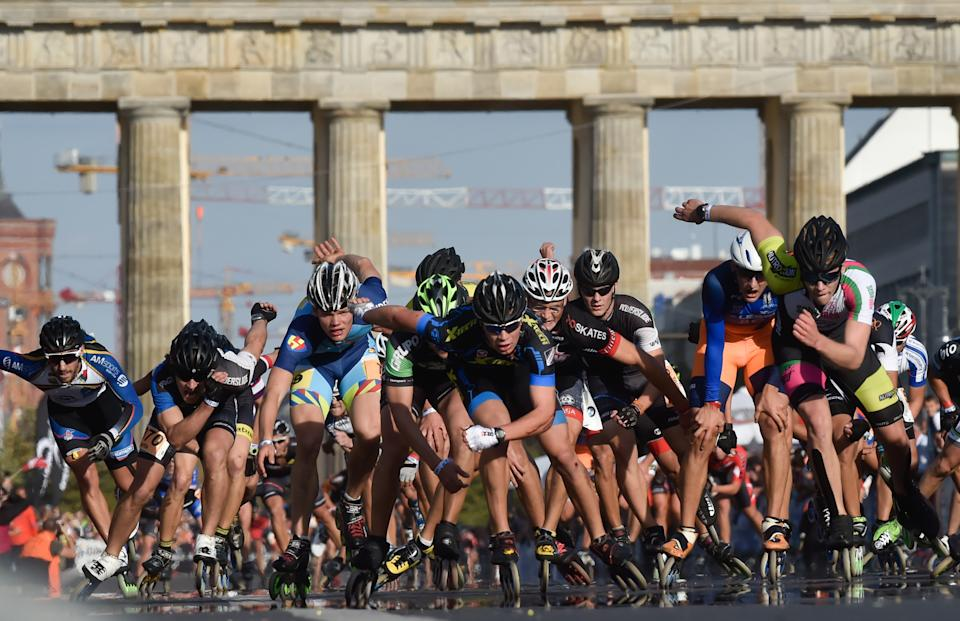 In-line skaters sprint towards the finish line during the in-line skating competition at the 2016 Berlin Marathon.