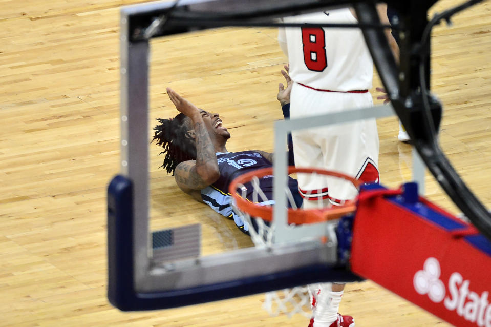 Memphis Grizzlies guard Ja Morant (12) laughs on the court in the second half of an NBA basketball game against the Chicago Bulls, Monday, April 12, 2021, in Memphis, Tenn. (AP Photo/Brandon Dill)