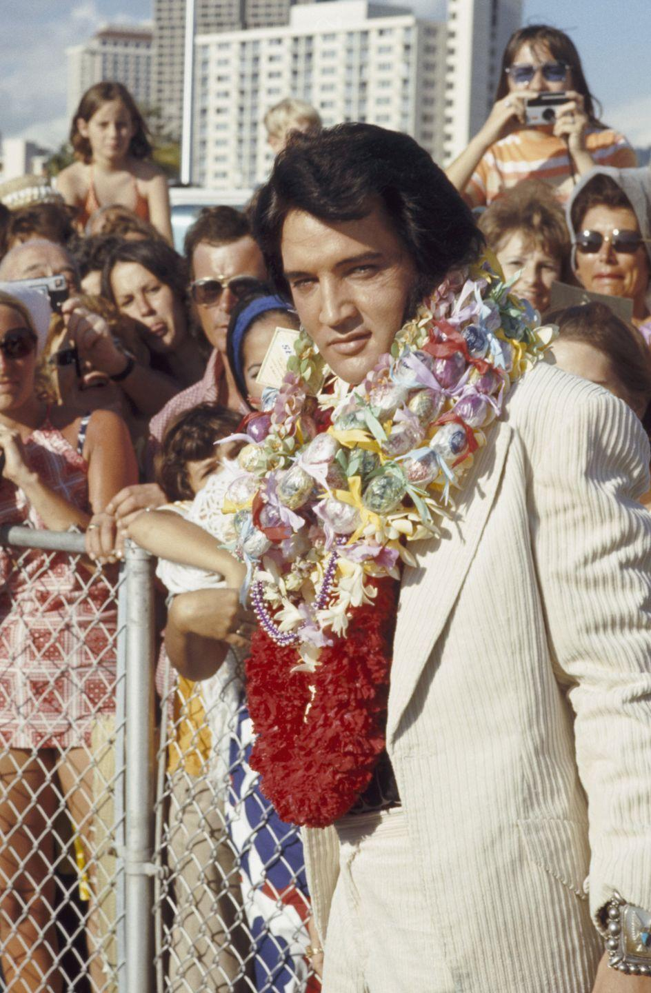 <p>Presley arrives in Honolulu, Hawaii for his internationally televised concert <em>Aloha From Hawaii. </em>The concert was broadcasted via live satellite, which was very savvy for the time and was a huge success. </p>