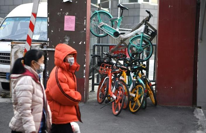 Bicycles bar the entrance to an apartment block in Beijing as residents seek to keep control of who can enter (AFP Photo/Noel Celis)
