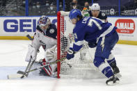 Columbus Blue Jackets goaltender Elvis Merzlikins makes a save against Tampa Bay Lightning's Anthony Cirelli during the second period of an NHL hockey game Thursday, April 22, 2021, in Tampa, Fla. (AP Photo/Mike Carlson)