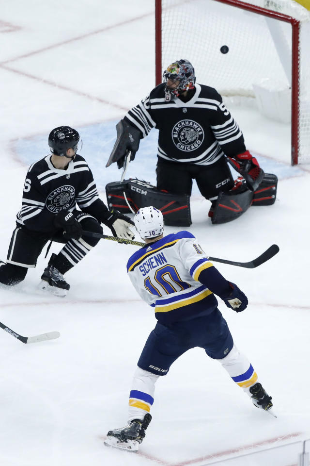 St. Louis Blues' Brayden Schenn (10) shoots and scores past Chicago Blackhawks goaltender Corey Crawford, top right, as Blackhawks' Olli Maatta watches during the third period of an NHL hockey game Monday, Dec. 2, 2019, in Chicago. (AP Photo/Charles Rex Arbogast)