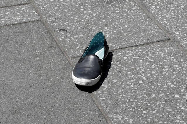 <p>A shoe lies o the sidewalk in Times Square after a speeding vehicle struck pedestrians on the sidewalk in New York City on May 18, 2017. (Mike Segar/Reuters) </p>
