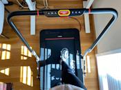 <p>Here's what the controls look like on the handrail. With the handrail up, you can walk or jog up to 5 mph. With it down, the max speed is 3.7 mph (which is plenty fast for walking while working).</p>