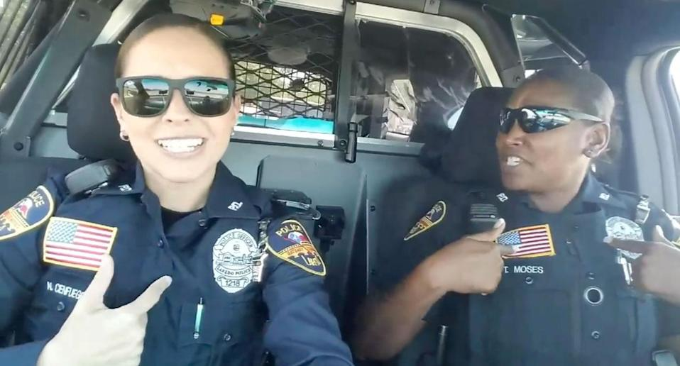 Texas police officers Noemi Cienfuegos and Tycola Moses have gone viral for their lip-syncing rendition of Spice Girls' Wannabe. Source: Facebook/ Laredo Police Department