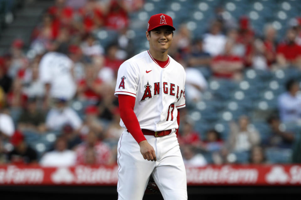 Los Angeles Angels starting pitcher Shohei Ohtani smiles as he leaves the field against Detroit Tigers during the first inning of a baseball game in Anaheim, Calif., Thursday, June 17, 2021. (AP Photo/Alex Gallardo)