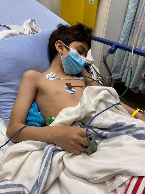 Seven-year-old Moises in his hospital bed in Miramichi Regional Hospital. Moises became ill Saturday after he ate cannabis cookies, thinking they were Oreos. (Tobi Leah Russo/Facebook - image credit)