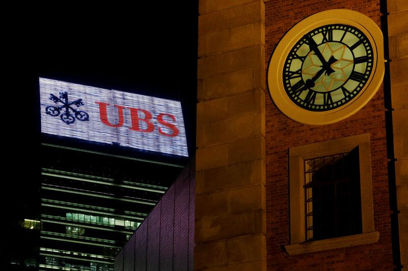 FILE PHOTO: A UBS advertisement is displayed on top of a commercial building in Hong Kong