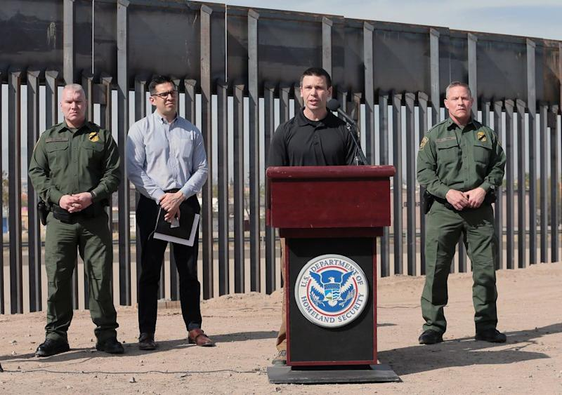 U.S. Customs and Border Protection Commissioner Kevin K. McAleenan, with the bollard border fence in the background, held a press conference in El Paso, Texas, on Mar. 27, 2019. McAleenan said the border has hit its
