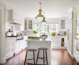 "<p>Natural light reflects off the kitchen's pure white walls and rich antique chestnut flooring, awakening the spirit of this 19th-century Connecticut home designed by <a href=""https://timothywhealon.com/"" rel=""nofollow noopener"" target=""_blank"" data-ylk=""slk:Timothy Whealon"" class=""link rapid-noclick-resp"">Timothy Whealon</a>. A roman shade in <a href=""https://www.kravet.com/"" rel=""nofollow noopener"" target=""_blank"" data-ylk=""slk:Kravet"" class=""link rapid-noclick-resp"">Kravet</a> fabric with <a href=""http://www.claremontfurnishing.com/"" rel=""nofollow noopener"" target=""_blank"" data-ylk=""slk:Claremont"" class=""link rapid-noclick-resp"">Claremont</a> trim adds softness to the modest space. The pair of stools are from <a href=""http://www.fair-design.com/"" rel=""nofollow noopener"" target=""_blank"" data-ylk=""slk:Fair"" class=""link rapid-noclick-resp"">Fair</a>. The ceiling paint color is Wimborne White by Farrow & Ball.</p><p><a class=""link rapid-noclick-resp"" href=""https://go.redirectingat.com?id=74968X1596630&url=https%3A%2F%2Fwww.farrow-ball.com%2Fen-us%2Fpaint-colours%2Fwimborne-white&sref=https%3A%2F%2Fwww.veranda.com%2Fdecorating-ideas%2Fcolor-ideas%2Fg28700927%2Fkitchen-paint-colors%2F"" rel=""nofollow noopener"" target=""_blank"" data-ylk=""slk:Get the Look"">Get the Look</a></p>"