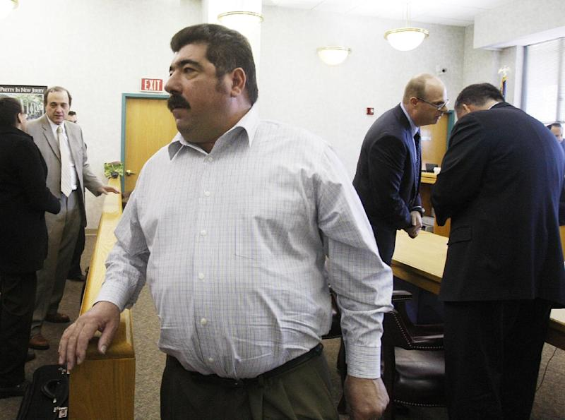 Americo Lopes exits the courtroom on Wednesday, March 14, 2012 in Elizabeth, N.J. A jury found that Lopes had cheated five co-workers out of their share of a $38.5 million lottery jackpot. The men worked at a construction company in Elizabeth and began a lottery pool in 2007. Americo Lopes claimed the winning numbers for the Nov. 10, 2009 jackpot were on a personal ticket and not the ticket that he had bought for the pool. The eight-member jury disagreed. (AP Photo/The Star-Ledger, Frances Micklow, Pool)