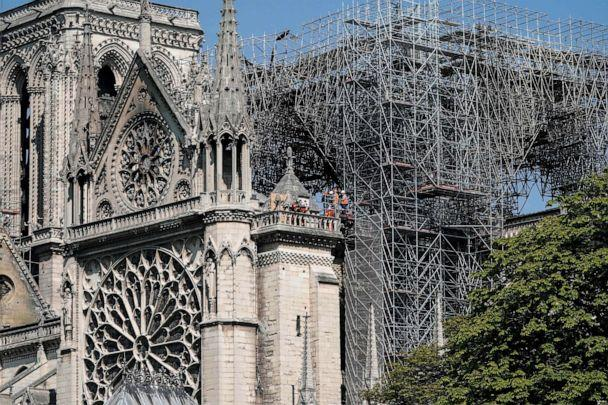 PHOTO: Firefighters and technicians work on a balcony of Notre-Dame de Paris Cathedral in Paris, April 19, 2019, four days after a fire devastated the cathedral. (Lionel Bonaventure/AFP/Getty Images)