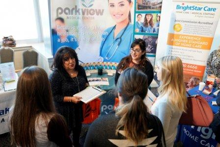 FILE PHOTO: Job seekers listen to a recruiter at the Colorado Hospital Association job fair in Denver, Colorado, U.S. on October 4, 2017. REUTERS/Rick Wilking/File Photo