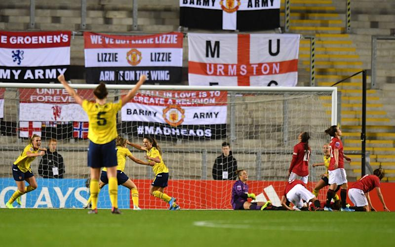 Danielle Van De Donk celebrates with her winning goal with her Arsenal teammates - PA