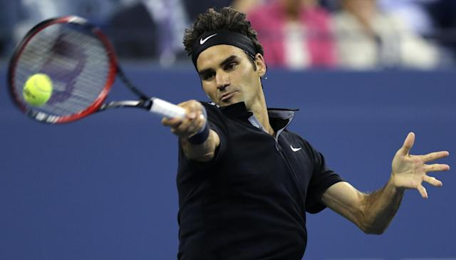 Roger Federer, of Switzerland, returns to Gael Monfils, of France, during the quarterfinals of the U.S. Open tennis tournament, Thursday, Sept. 4, 2014, in New York. (AP Photo/Charles Krupa)