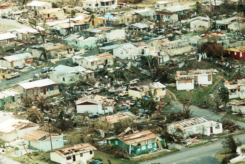 FILE-In this September 18, 1989 file photo shows extensive damage to homes in the Ocean Park Section of San Juan, Puerto Rico, caused by Hurricane Hugo. The Category 4 storm caused extended damage in the Caribbean before making landfall in South Carolina. The storm cost $9.5 billion in damage. (AP Photo, File)
