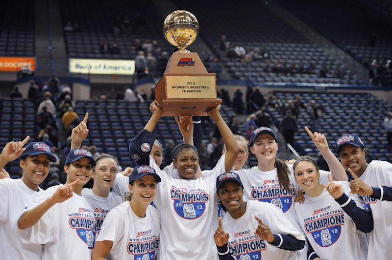 Connecticut's Tiffany Hayes, center and her teammates hold up the Big East women's tournament championship trophy after their 63-54 win over Notre Dame in an NCAA college basketball game in Hartford, Conn., Tuesday, March 6, 2012. (AP Photo/Jessica Hill)