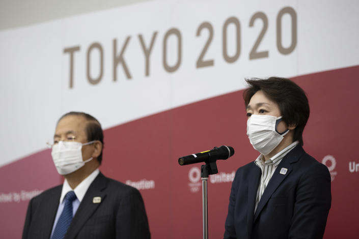 Tokyo 2020 Organizing Committee President Seiko Hashimoto, right, speaks to media after a video conference with the IOC executive board on Wednesday, Feb. 24, 2021, in Tokyo. Hashimoto, a former Olympics minister and seven time Olympian, was recently appointed the Tokyo 2020 president after her predecessor Yoshiro Mori quit following a backlash over sexist comments he made at an earlier meeting. (Takashi Aoyama/Pool Photo via AP)