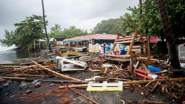PHOTO: People stand among the debris at a restaurant in Le Carbet, on the French Caribbean island of Martinique, after it was hit by Hurricane Maria, on September 19, 2017. (Lionel Chamoiseau/AFP/Getty Images)